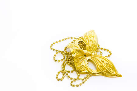 Mardi Gras gold beads and mask on white backgound. Stock Photo - 17874152