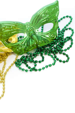 Mardi Gras beads and colorful masks on white backgound. Imagens