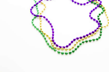 bead: Multi color Mardi Gras beads on white background.