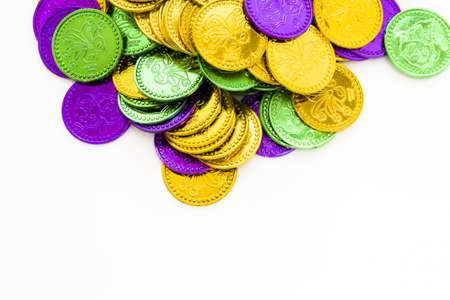 tokens: Multi color Mardi Gras tokens on white background.