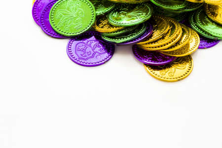 tokens: Multi color Mardi Gras tokens on white background.