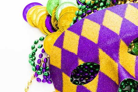 Multi color Mardi Gras beads, tokens and mask on white background. Stock Photo - 17908521