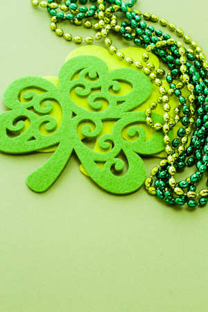 St. Patricks Day doilies on green background. photo