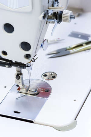 nad made: Sewing machine in tailor shop  Stock Photo
