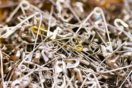 Silver safety pins in a pile. Stock Photo - 17908430
