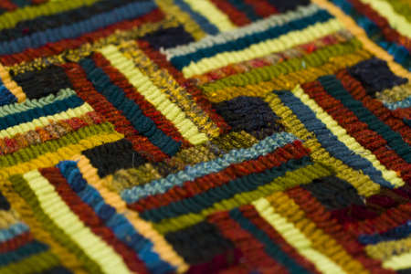 nad made: Work in progress of rug hooking. Stock Photo