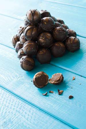 Gourmet dark milk chocolate truffles hand made by chocolatier. Stock Photo