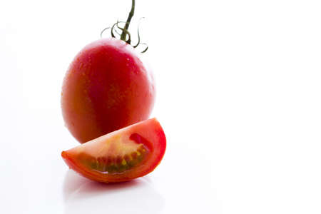 Organic Roma tomatoes on white background. Stock Photo