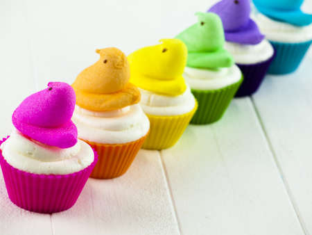 Easter cupcakes with marshmallow chicks. photo