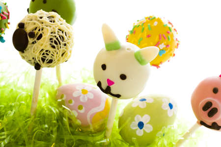 Dark chocolate Easter cake pops decorates with faces of different animals. photo