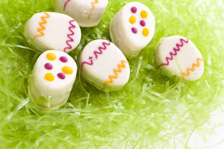 Easter egg petit cakes made with layers of vanilla cake and tart, raspberry jam. Stock Photo - 18189145