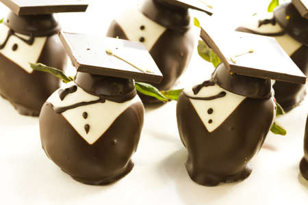 fresh graduate: Gourmet chocolate covered strawberries decorated for graduation party.