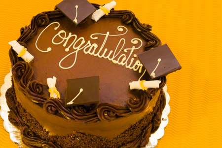 Gourmet chocolate cake decorated for graduation party. photo