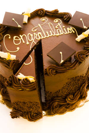Gourmet chocolate cake decorated for graduation party.