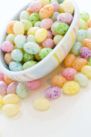 Assorted jelly beans in pastel colors with darker spots. photo