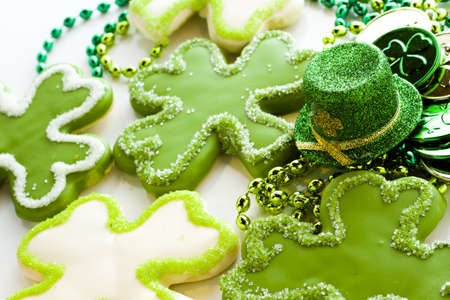 st: White chocolate shorrbread cookies in shape of four clover leaf for St. Patrics Day.