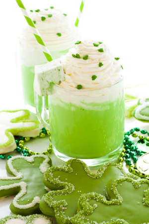 White chocolate shorrbread cookies in shape of four clover leaf with green hot chocolate. Stock Photo - 18417794