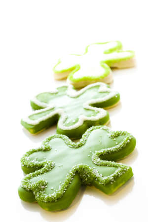 patrics: White chocolate shorrbread cookies in shape of four clover leaf for St. Patrics Day.