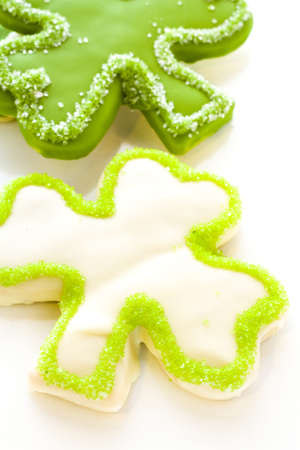 st patrics: White chocolate shorrbread cookies in shape of four clover leaf for St. Patrics Day.