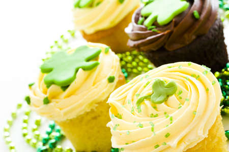 st patrics: White chocolate cupcakes with white chic mousse and white buttercream frosting for St. Patrics Day.