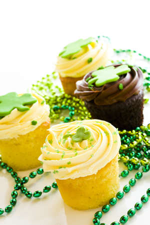 patrics: White chocolate cupcakes with white chic mousse and white buttercream frosting for St. Patrics Day.
