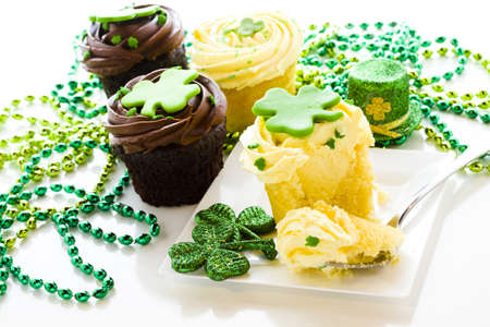 White chocolate cupcakes with white chic mousse and white buttercream frosting for St. Patrics Day. photo