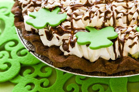Chic pie crust with chic mousse and white chic mint mousse with whip cream on top.