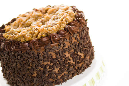 pastrie: German chocolate cake with two layers of chocolate cake filled and topped with classic German chocolate filling (a caramel-goo of coconut and pecans), covered in chocolate buttercream. Stock Photo