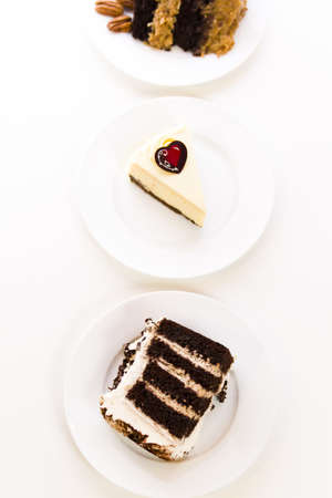 pastrie: Slices of gourmet chocolate cakes on plates. Stock Photo