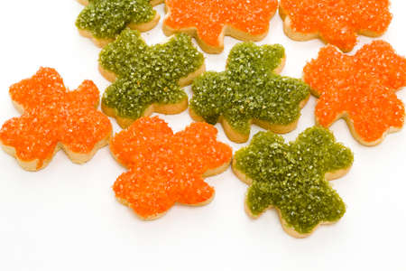 patrics: St Patrics hand frosted clovers in orange and green.
