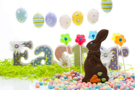 Chocolate Easter bunny with other Easter candies.