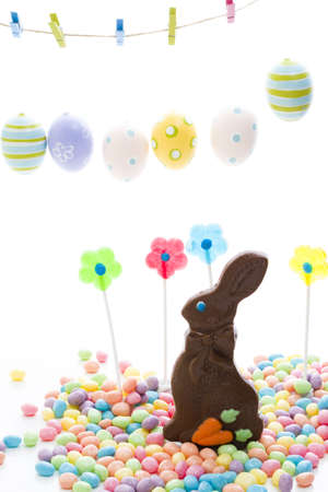 Chocolate Easter bunny with other Easter  candies. Archivio Fotografico