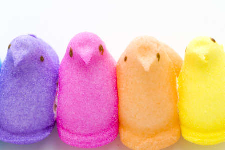 Rainbow color marshmallow peeps and jelly beans.
