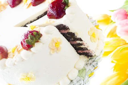 Chocolate Strawberry Lemon Torte made with 6 layers of chocolate cake, filled with lemon curd and strawberry mousse, covered in white chocolate cream cheese frosting. photo