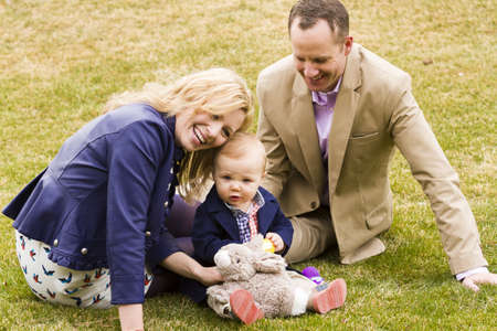 A young family with baby boy in the park on a nice Spring day. photo