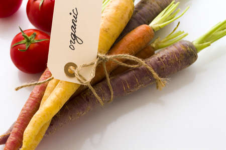 Organic rainbow carrots and tomatoes from the local farm. photo