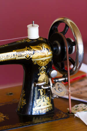 Old sewing machine in gold and black.