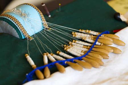 Demonstration of old bobbin lace craft.