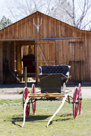 oldie: Old carriage with red wheels on display. Stock Photo