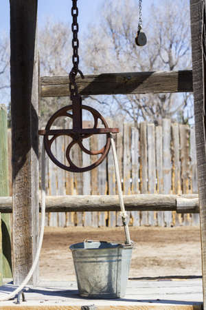 water well: Old fashioned water well on the farm.