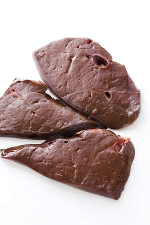 Raw beef liver on a white backgroung.