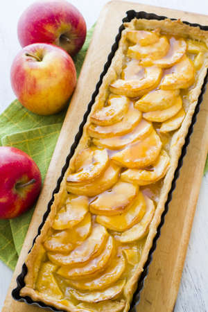 French apple tart made with red apples and apricot glaze.