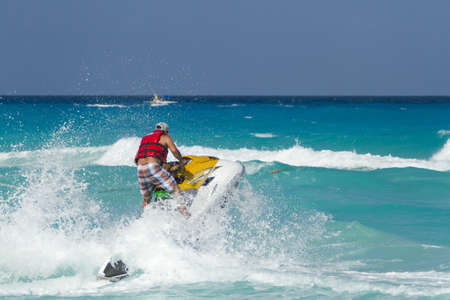 Having fun on jet ski at the Caribbian sea.