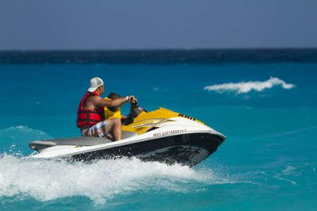 watercraft: Having fun on jet ski at the Caribbian sea.