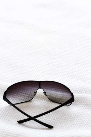 black sunglasses on fabric.