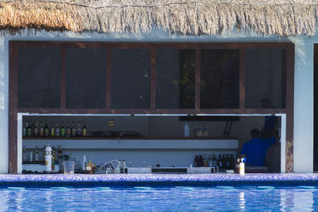 Empty swimming pool bar at vation resort in Mexico.
