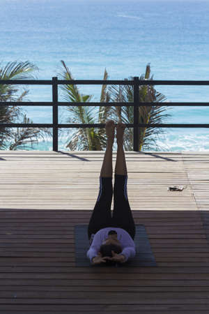 stratching: Morning yoga class at the cation resort in Mexico. Editorial