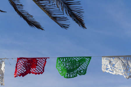 Traditional papel picado decorating a garden. photo