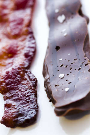 chocolate covered bacon: Chocolate covered bacon with salt. Stock Photo