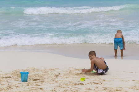 vacationing: Vacationing on the beach of the Caribbean Sea.